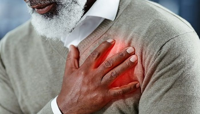 Shot of a senior man holding his chest in discomfort